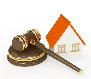 gavel next to a house