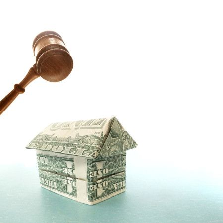 gavel and a house made of money